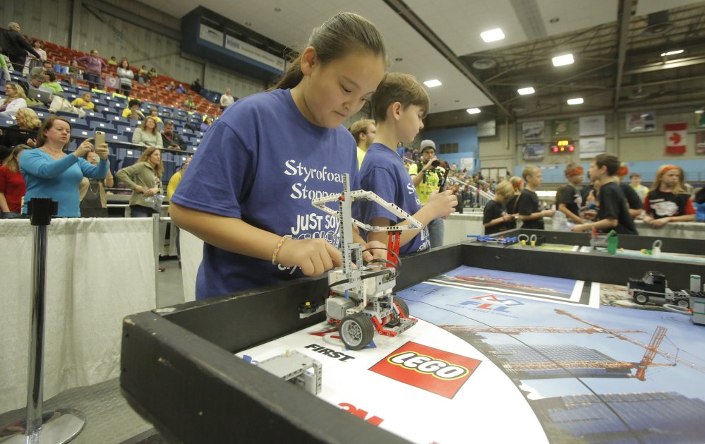 MinGe Daley, a fifth-grader at Sea Road School in Kennebunk, waits to start her team's robot Saturday in the third round of competition at the Maine FIRST LEGO League State Championship at the Augusta Civic Center. Sixty teams from around the state competed in the championship.