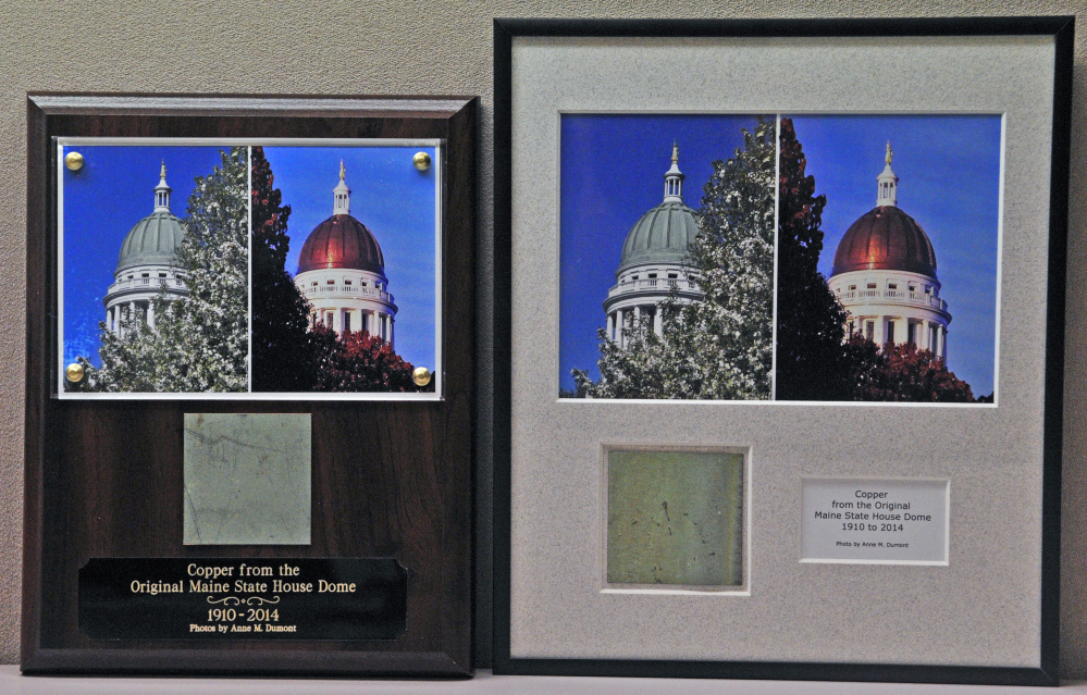 These plaques with a piece of old State House dome copper, along with before and after photos by Anne Dumont, are in the Office of The Executive Director of the Legislative Council.