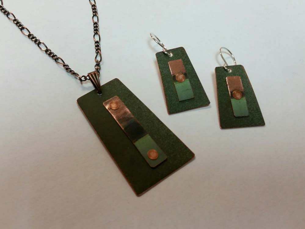 Bangor artist Roxanne Munksgaard is turning old copper from the State House dome into jewelry.
