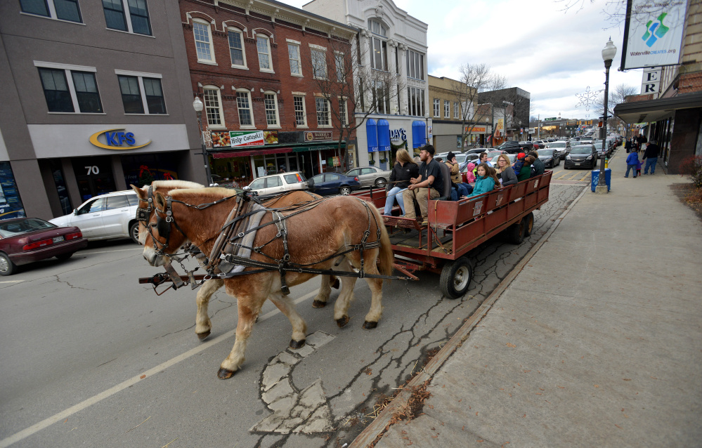 Free horse-drawn wagon rides were available Saturday on Main Street during the Downtown Waterville Open House.