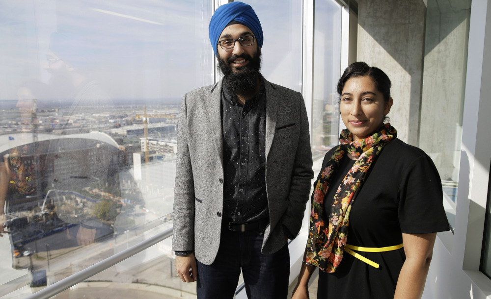 In this Dec. 11, 2015, photo, Darsh Singh, left, poses for a photo with his wife, Lakhpreet Kaur, in Dallas.