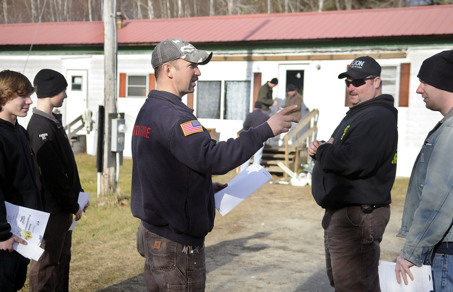 Pittston Fire Chief Jason Farris, center, directs fellow volunteers on Sunday to hand out fliers to residents that offer free fire detectors. Anyone who contacts the town office at 582-4438 before Dec. 18 will receive a detector along with free installation by the Fire Department. The installations will take place between 9 a.m. and 3 p.m. on Jan. 2, Farris said. He said there is no limit on the number of detectors firefighters can give out during the Home Fire Preparedness Campaign. Residents can have just two minutes to get out of a house once a fire breaks out, according to the American Red Cross. People die in a fire an average of seven times every day in the U.S., and someone is hurt every 40 minutes.