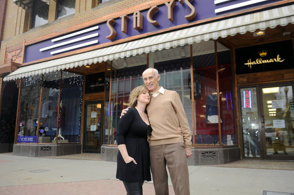 Stacy Gervais and her father, Richard Cummings, outside of their Augusta business on Monday. Stacy's Hallmark is closing after more than four decades on Water Street.