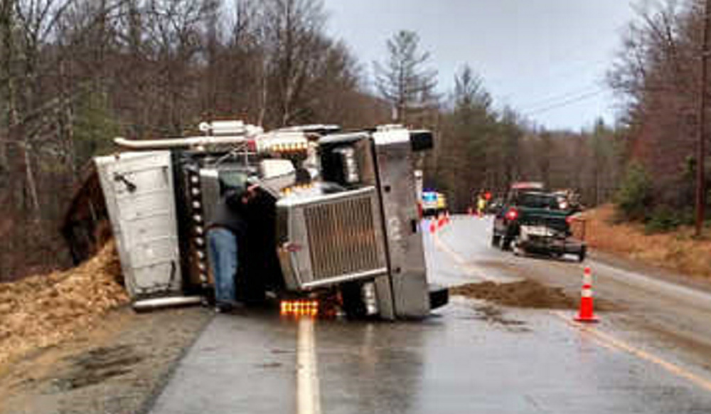 A tractor-trailer carrying wood chips rolled over Tuesday morning on Route 27 in Kingfield, near the Carrabasset town line. No one was injured.