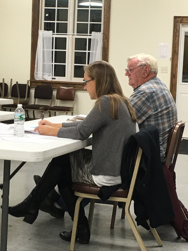 Attorney Mary Denison and her client, Dick Condon, who seeks permission to operate a gravel pit, attend a public hearing Tuesday in Dresden.