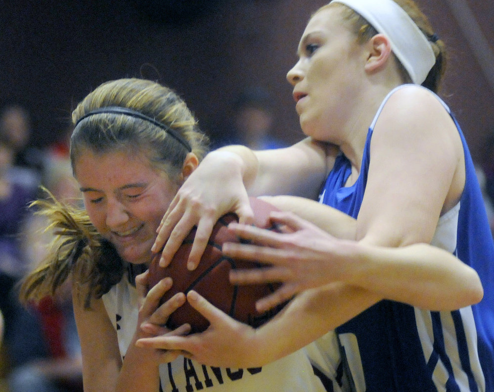 Monmouth's Abbey Allen grapples with Madison's Lauren Hay during a Mountain Valley Conference game Tuesday night in Monmouth.