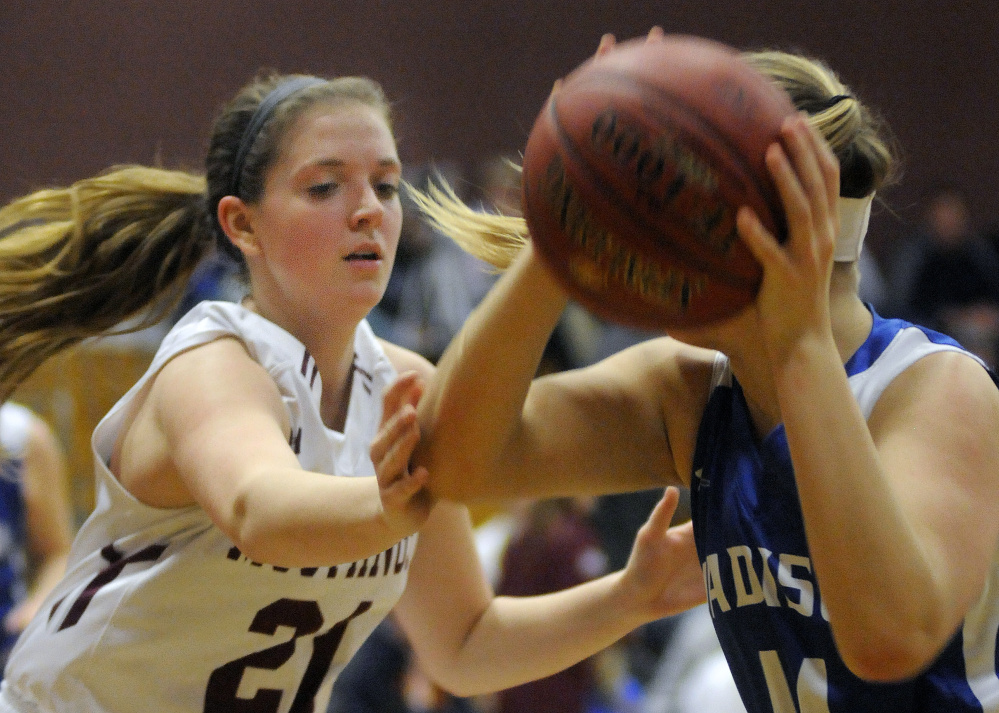 Monmouth's Haley West blocks Madison's Erin Whalen during a Mountain Valley Conference game Tuesday night in Monmouth.