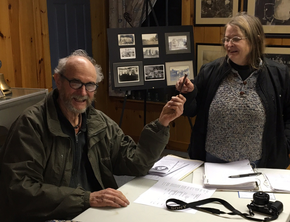 Rodney Porter, left, retiring president of the Western Maine Blacksmith Association, accepts a wrought iron nail as a token of appreciation from Janine Winn, club treasurer.