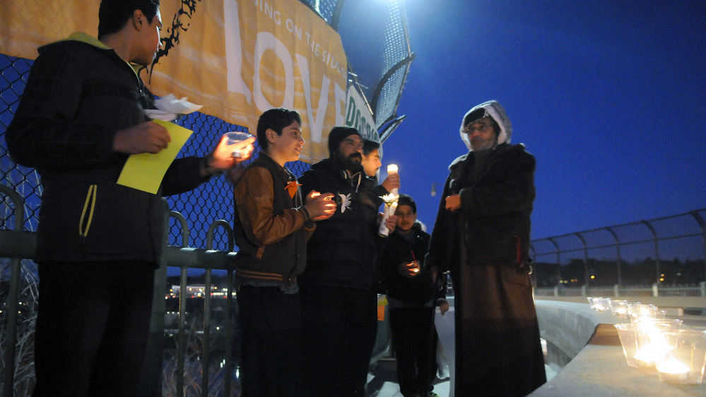 The Capital Area Multifaith Association and the Winthrop Area Ministerial Association organized this Lighting up Augusta With Hope and Love vigil Wednesday on Memorial Bridge in Augusta.