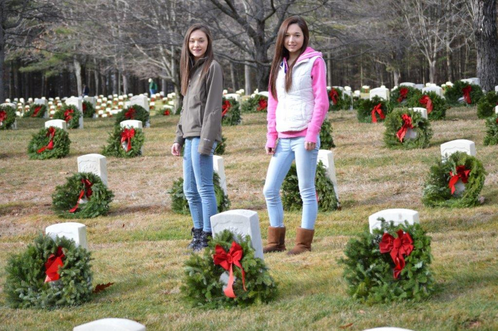 Tailah, left, and Hannah Mills, both of West Gardiner, volunteered in Wreaths Across America event at Togus VA in Augusta. Hannah is a junior at Gardiner High School and  Tailah is in 8th grade at Gardiner Middle school.  This was their first year volunteering to place the wreaths, on National Wreath Across America day honoring our past and present Veterans.