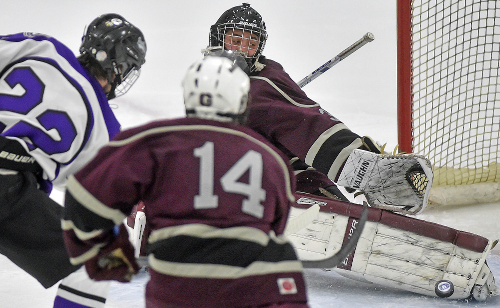 Greely High School goalie Joe McDonald (30) makes a toe save on a shot from Waterville Senior High School's Cody Pellerin (22) in the second period at Colby College on Thursday.