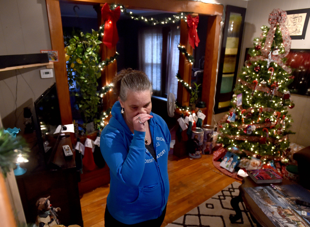 Carrie Harvey becomes emotional Thursday at her home in Waterville as she talks about her brother Michael Bowles, who needs a kidney transplant.