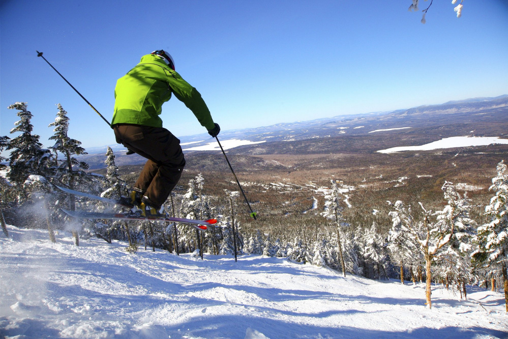 A skier shoots down Saddleback Mountain's 44-acre glade , Casablanca, two years ago. The mountain, which was slated to possibly not open this year, may now open in January after a possible new owner stepped up.