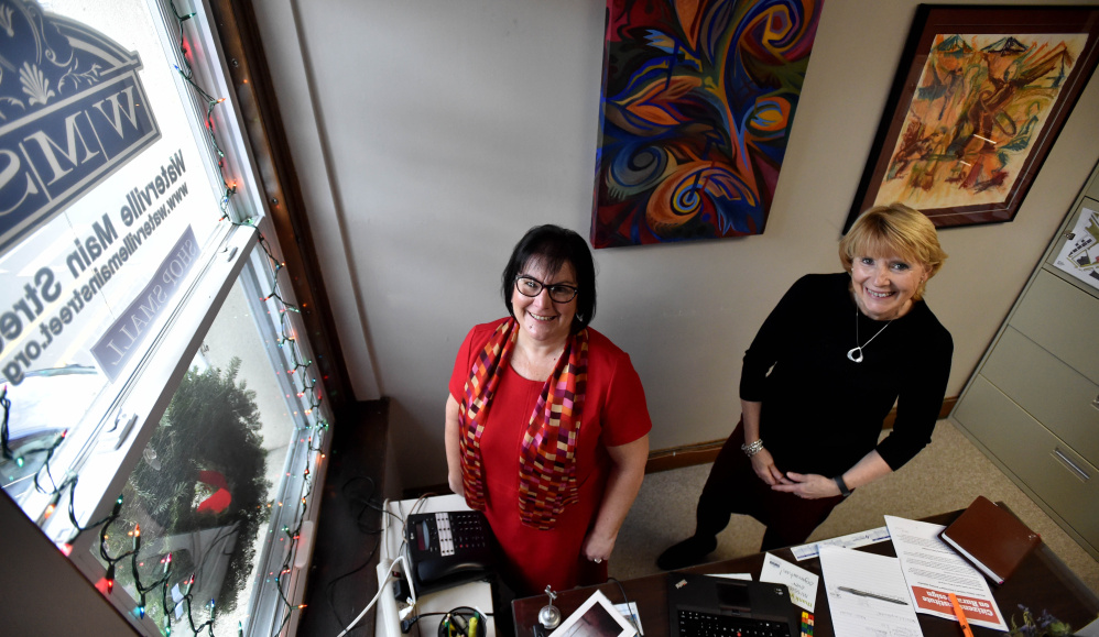 Jennifer Olsen, executive director of Main Street Waterville, left, and June L'Heureux, Main Street Waterville office manager, pose on Friday at the Main Street Waterville office. Olsen will be stepping down from her post Jan. 1 and L'Heureux will assume Olson's duties until the board of directors can fill the position.