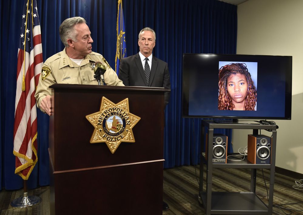 Clark County Sheriff Joe Lombardo, left, and Clark County District Attorney Steve Wolfson attend at a news conference in Las Vegas. The two officials spoke about the car driven by suspect Lakeisha N. Holloway, pictured on monitor, of Oregon, who was charged Tuesday with murder, child abuse and hit-and-run.