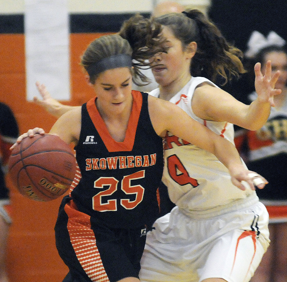 Gardiner Area High School's Lauren Chadwick guards Skowhegan Area High School's Sydney Ames during a game Tuesday in Gardiner.