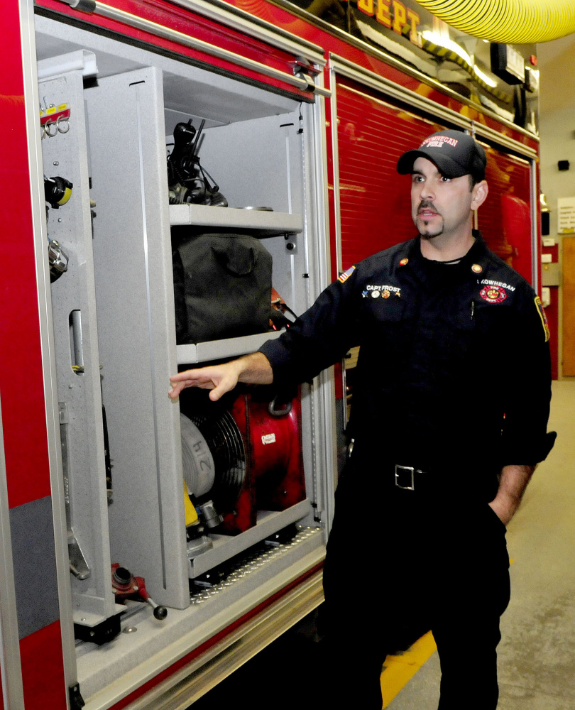 Skowhegan Fire Department Capt. Jason Frost speaks about the added compartment room for equipment in the departments' new rescue/pumper truck, Engine 10, on Tuesday.