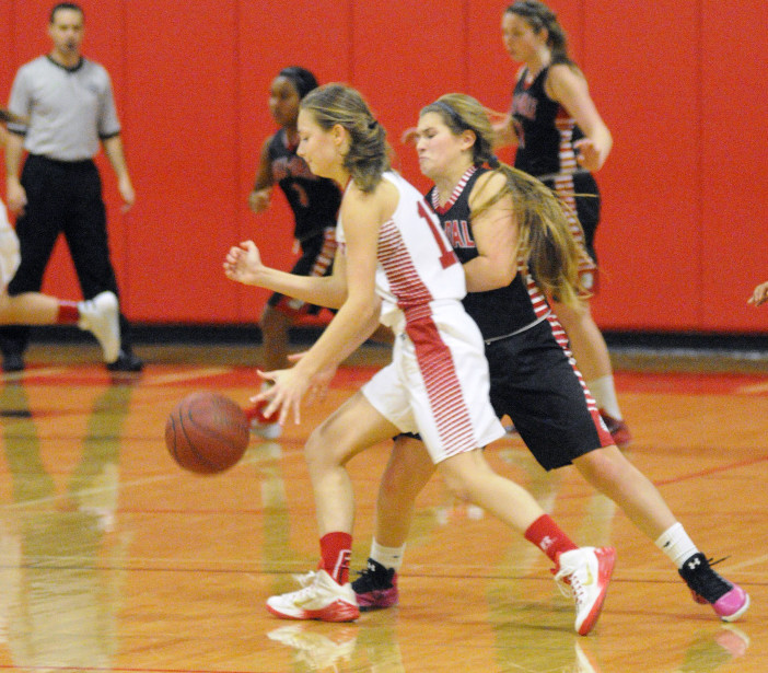 Cony's Haley Ward, left, is defended by Hall-Dale's Emma Begin during the Chrisanne Burns Memorial Tournament last month at Cony High in Augusta. Ward has played strong for the young Rams this season.