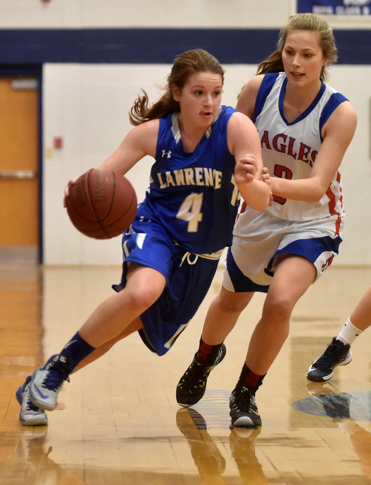 Lawrence's Morgan Boudreau, left, drives past Messalonskee guard Sophia Holmes during a Class A North game earliers this month in Oakland. Messalonskee lost but has since gone on a five-game winning streak while Lawrence remains unbeaten.
