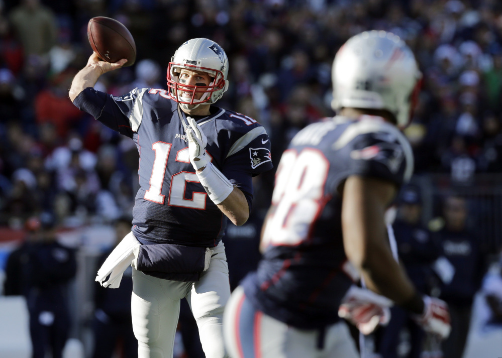 New England Patriots quarterback Tom Brady (12) passes to running back James White (28) in the first half against the Tennessee Titans on Sunday in Foxborough, Mass. Brady and the Patriots will take on the New York Jets on Sunday.