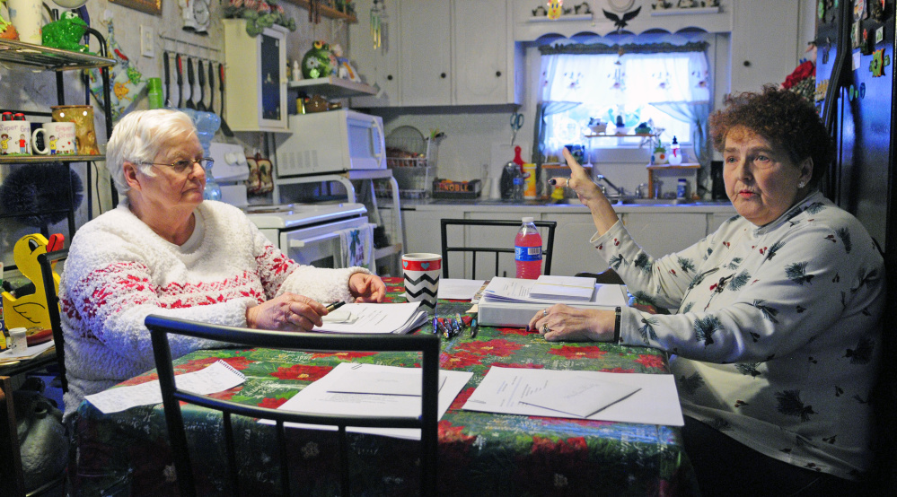 Treasurer Gertrude Turcotte, left, and Secretary Beverly Chase talk about the board's plans for the park on Dec. 15 at Deer Ridge Mobile Home Park in Augusta.