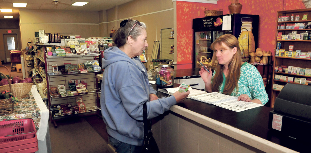Ginny Jewell, right, owner of Ginny's Natural Corner, waits on customer Irene Quirion at the 78 Water St. store in October. Jewell is one of four finalists in the Entrepreneur Challenge sponsored by Main Street Skowhegan and Skowhegan Savings Bank.