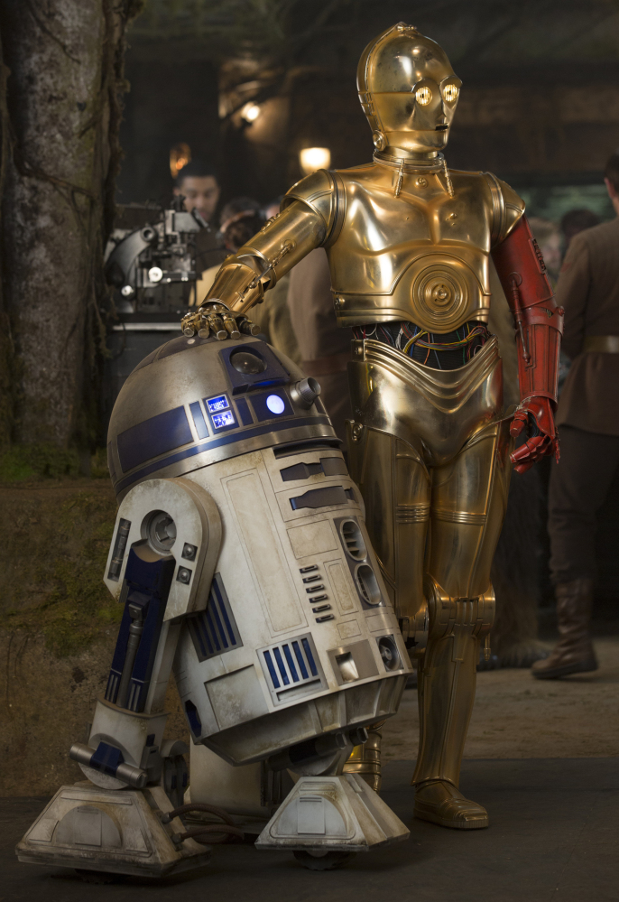 "R2-D2, left, and C-3PO share a scene from the new film, ""Star Wars: The Force Awakens."""