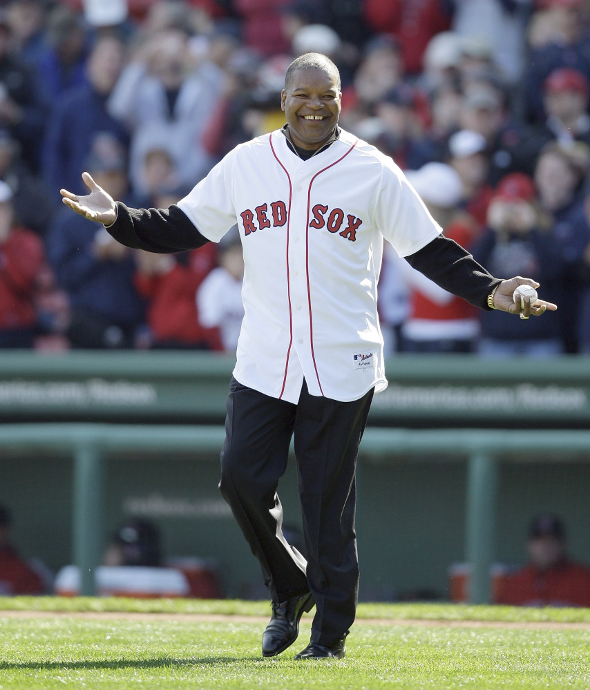 In this Oct. 11, 2009 photo former Boston Red Sox outfielder Dave Henderson walks onto the field to throw out the ceremonial first pitch before Game 3 of an American League baseball division series between the Boston Red Sox and Los Angeles Angels in Boston. Henderson, who hit one of the most famous home runs in postseason history, died Sunday after suffering a massive heart attack. He was 57.