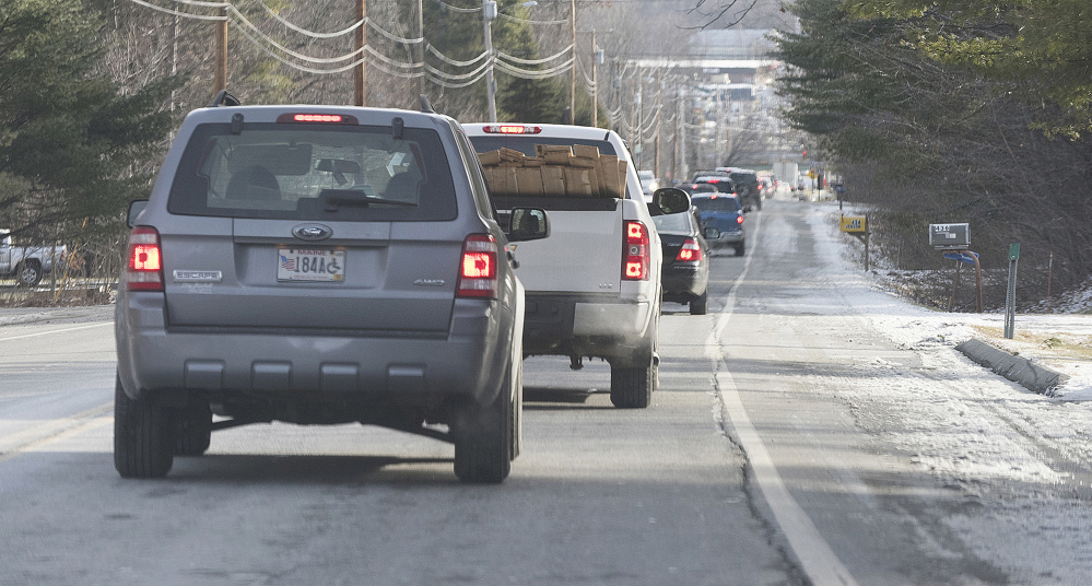 Traffic backs up along Route 104 going into Waterville from Fairfield last Monday morning. Summit Natural Gas line work at the interesection of Armory Road and Main Street backed up traffic in all directions for several hours.