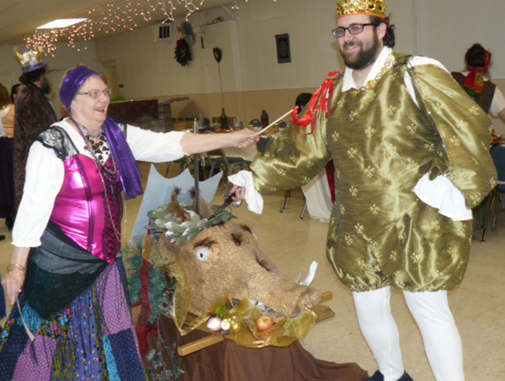 Two members of the Recycled Shakespeare Company community theater: Dale Sturtevant, left, of Oakland, and Josh Fournier, of Fairfield, fight for the boar's head at Madcap Madrigal.