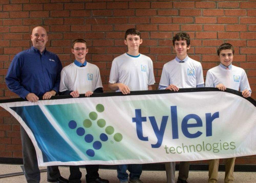 Ray Arbour, project manager, Tyler Technologies, left, with the winners of the Tyler Technologies Maine App Challenge, from left, Collin Clark, James Newkirk, Luke Bartol and Isaac Bell.