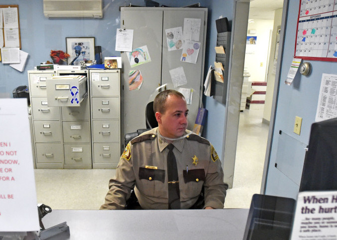 Deputy John Morris, with the Madison division of the Somerset County Sheriff's Office, works the desk on Thursday, Dec. 23. The Madison Police Department was absorbed by the Somerset County Sheriff's office in June 2015.