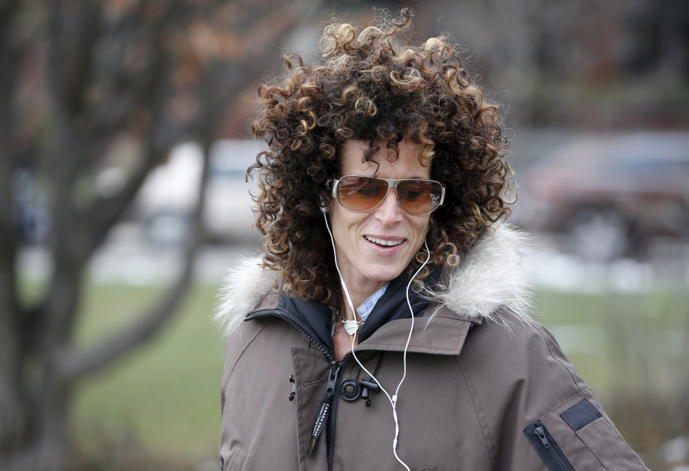 Andrea Constand, who accuses Bill Cosby of sexually assaulting her, walks in a park in Toronto on Wednesday. Cosby was charged Wednesday with sexually assaulting Constand at his home in 2004, in the first criminal case against the comedian accused of misconduct by dozens of women.