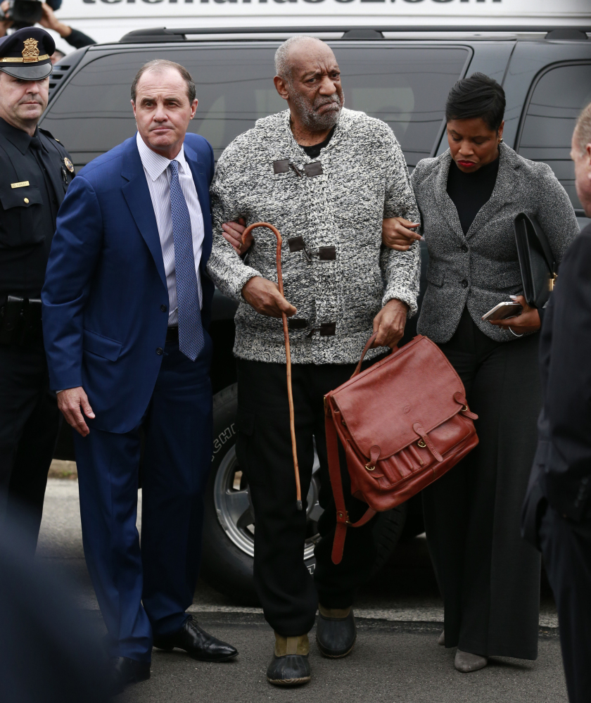 Bill Cosby is helped as he arrives for his court appearance Wednesday in Elkins Park, Pa.