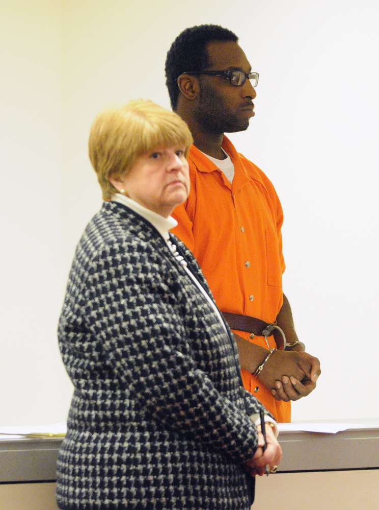 Defense attorney Pamela Ames stands with David W. Marble Jr. during his initial appearance on double murder charges on Wednesday at the Capital Judicial Center in Augusta.