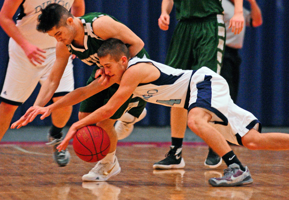 Winthrop's Nate Scott, top, and Dirigo's Luke Lueders battle for a loose ball during the Capital City Hoops Classic on Wednesday at the Augusta Civic Center.