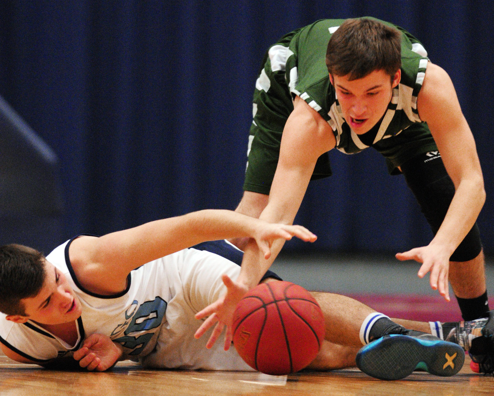 Winthrop's Bennett Brooks, top, and Dirigo's Alex Gorham battle for a loose ball during the Capital City Hoops Classic on Wednesday at the Augusta Civic Center.