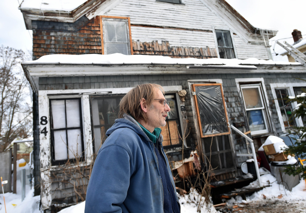 Robert Von Husen, stands in front of his Pine Street duplex in Madison on Thursday after a fire damaged part of the porch in the early morning hours. The fire was spotted by two Canadian truck drivers who passed by the home after delivering their loads to Madison Paper. Von Husen was at work at the time the fire was spotted and would like to extend a thank-you to the truck drivers, who left without giving their names, who put out the fire with snow and saving his home and family.