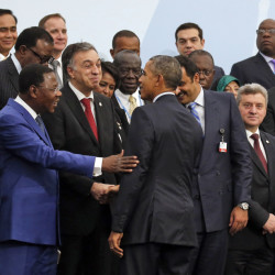"President Obama is greeted by the president of Benin, Thomas Boni Yayi, as Obama arrives for a photo with other world leaders at the climate change conference outside Paris. ""No nation large or small, wealthy or poor, is immune"" from the threat, Obama said."