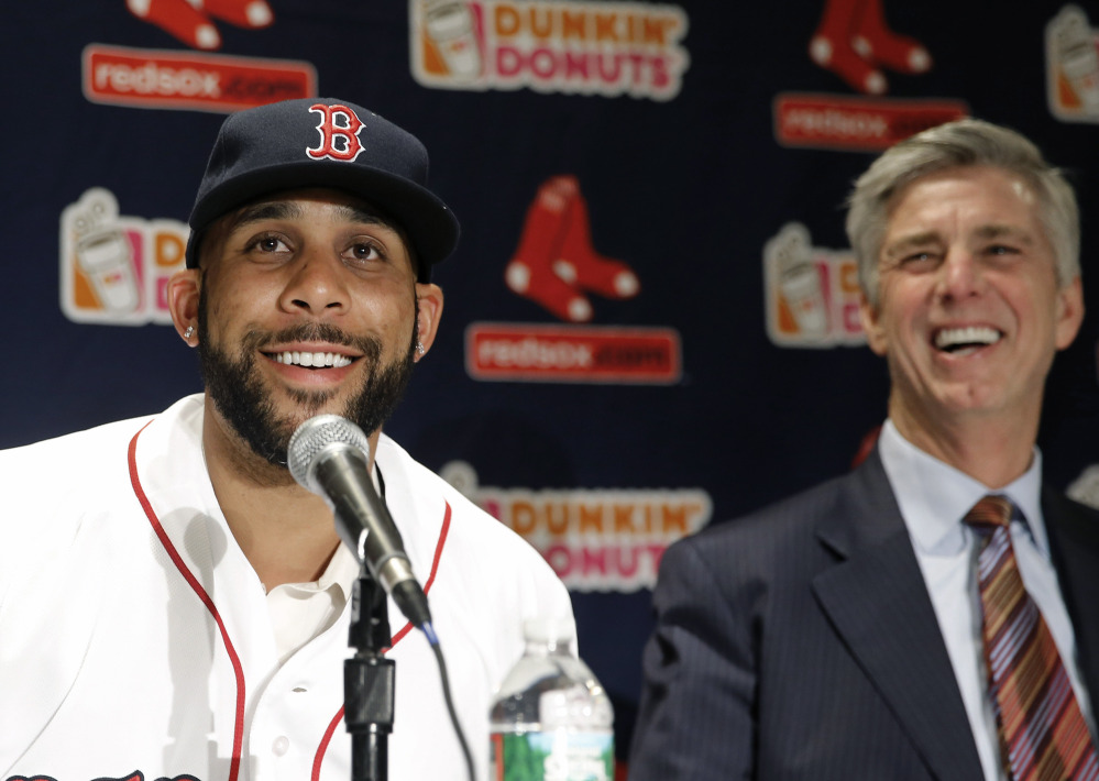 "New Red Sox pitcher David Price smiles with President of Baseball Operations Dave Dombrowski at Friday's news conference at Fenway Park announcing his signing of a seven-year contract worth $217 million. Red Sox owner John Henry said, ""We're going to see one of the best pitchers in baseball every five days."""