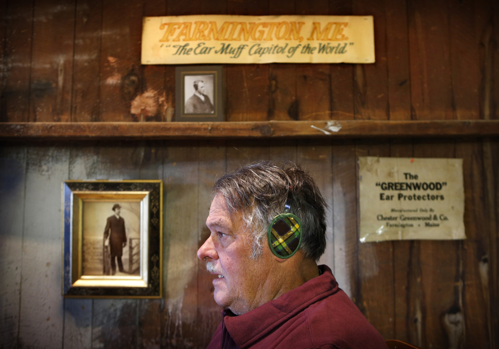 "Ronald Greenwood, 75, a great-grandson of Chester Greenwood, models a pair of original ""Champion Ear Protectors"" in his barn in Farmington."