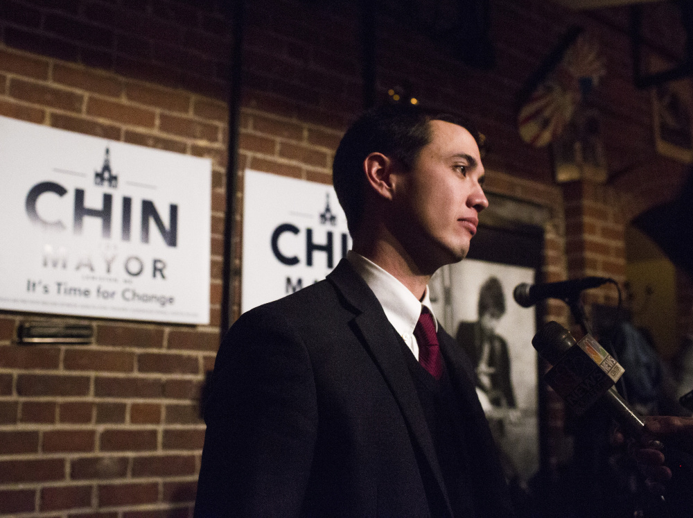 Ben Chin speaks with his supporters Tuesday night after losing the Lewiston mayoral runoff election against Robert Macdonald. He said he hasn't given much thought to his future in politics. Whitney Hayward/Staff Photographer