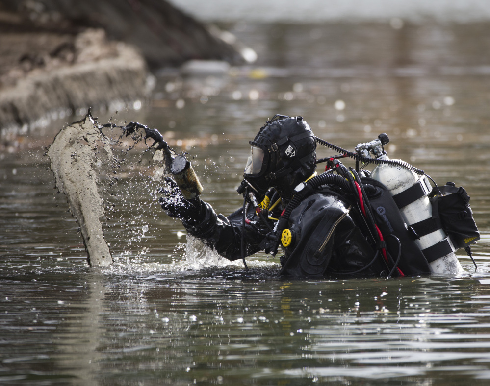 An FBI dive team on Friday continued searching Seccombe Lake for evidence linked to last week's terror attack in San Bernardino, Calif.