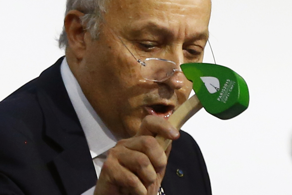 French Foreign Minister Laurent Fabius finally put the hammer down Saturday to seal a global agreement asking all countries to reduce or rein in greenhouse gas emissions. The Associated Press