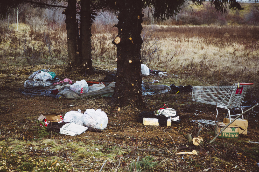 """Multiple tents, food waste, hypodermic needles and a rusted gun were among the items removed by state crews from a camp near the Exit 5 off-ramp on I-295. """"These places are bad. Our crews have to be very careful cleaning this stuff,"""" said Tim Cusick of the Maine DOT."""