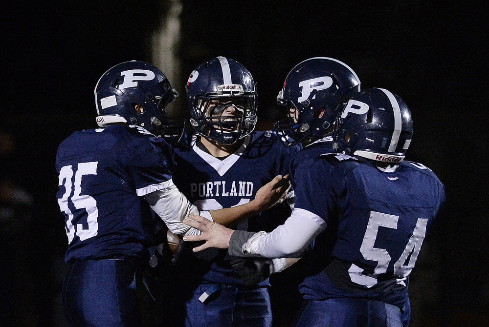 Portland's Joseph Esposito, center, is one of three finalists for the James J. Fitzpatrick Trophy, which is awarded to the top senior high school football player in the state.