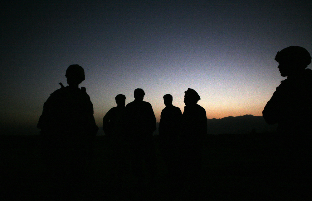 U.S. Army soldiers stand with Afghan policemen before a joint patrol of Qalanderkhail, outside of Bagram Airfield in Afghanistan in this file photo.