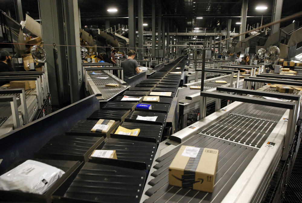 Parcels make their way along some of Worldport's 155 miles of conveyor belts in Louisville, Ky.