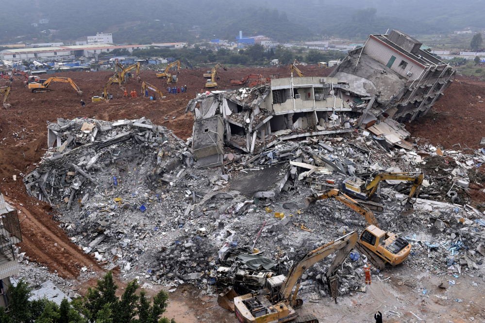 Nearly 3,000 people were involved in rescue efforts in Shenzhen, China, after a man-made mountain of dirt, cement chucks and construction waste came sliding down Sunday. The government said Monday 85 people were missing. The Associated Press