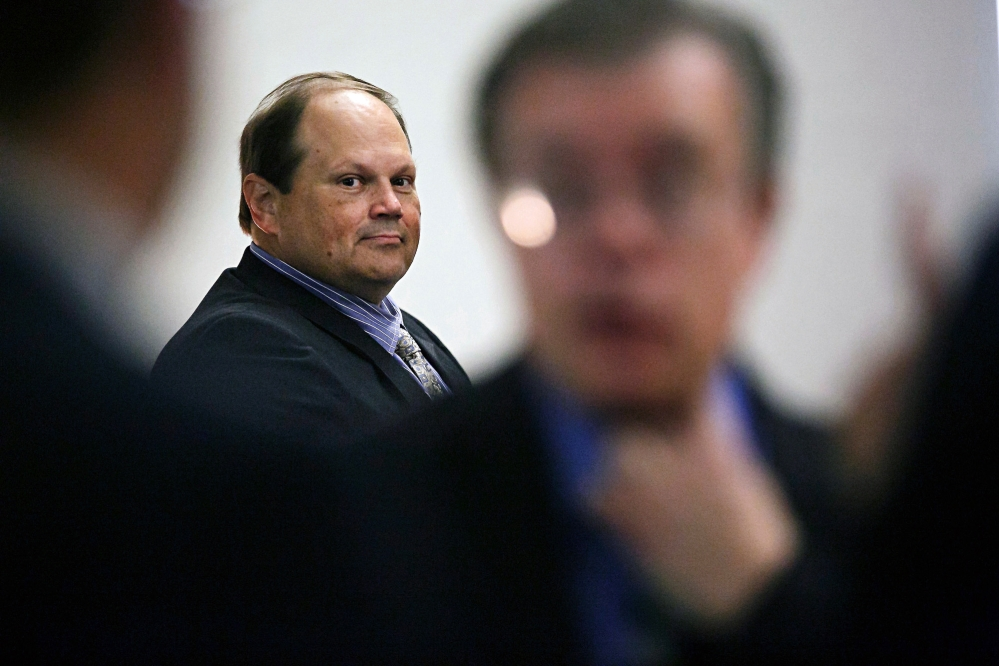 Eddie Tipton looks over at his lawyers before the start of his trial in Des Moines, Iowa, in this July 15, 20-15 file photo. The former security director of the Multi-State Lottery Association, accused of tampering with lottery drawings to rig jackpots in four states, was convicted of fraud in the attempt to claim a $16.5 million jackpot in Iowa. Investigators are now looking at payouts in 37 other states.